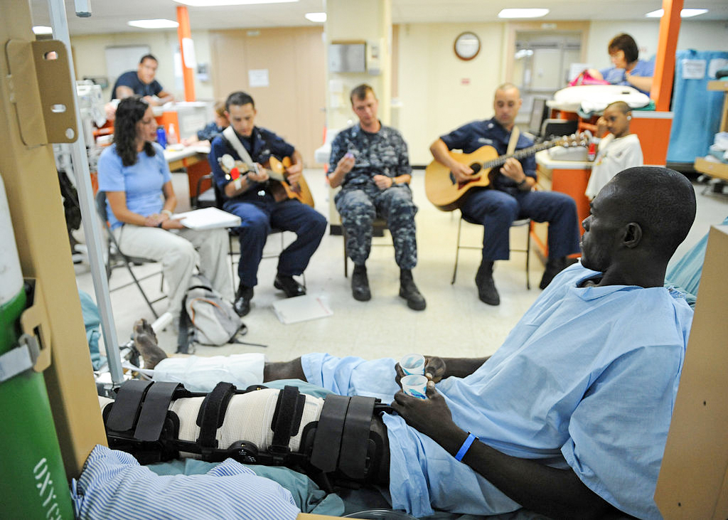 1024px-US_Navy_110610-N-NY820-215_U.S._Fleet_Forces_Band_members_and_Latter_Day_Saints_Charities_volunteers_play_music_for_Patients_aboard_the_Military_Se